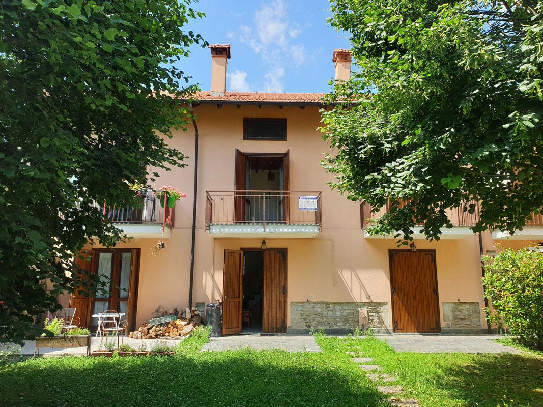 ARMENO Villetta a schiera con giardino privato